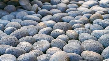Fondo de textura de piedra de mar de guijarros redondos lisos abstractos foto