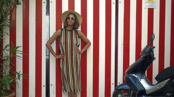 A woman with stripes when traveling in a luxury resort town in Italy, Europe. video