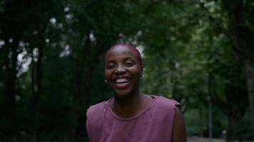 Portrait of young woman in park smiling and laughing photo