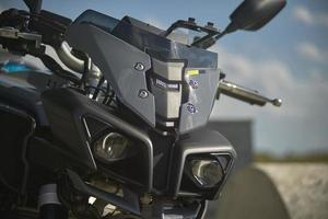 The lens of a modern motorcycle, the solution for greater safety and light conditions. photo