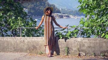 A woman looks at a Mediterranean Sea beach club in a luxury resort town in Italy, Europe. video