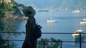 A woman walking by the Mediterranean Sea beach club in a luxury resort town in Italy, Europe. video