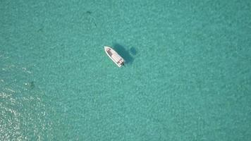Aerial drone view of a fishing motor boat in the Bahamas, Caribbean. video