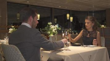 A man and woman couple dining in a luxury restaurant. video