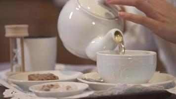 A woman pouring tea in a hotel room at a ski resort. video