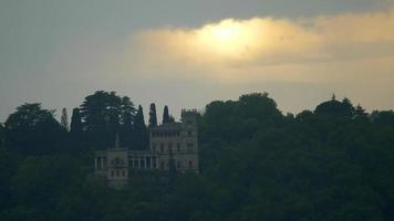 Stormy sunset over a villa in a luxury resort town near Lake Como, Italy, Europe. video
