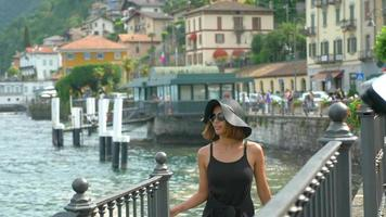 A woman traveling in a luxury resort town near Lake Como, Italy, Europe. video