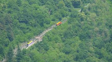 A funicular cable car goes up the hill on Lake Como, Italy, Europe. video