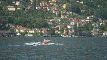 Traveling on a boat in near a luxury resort town on Lake Como, Italy, Europe. video