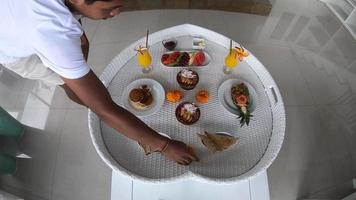 A breakfast tray meal is prepared at a resort hotel. video