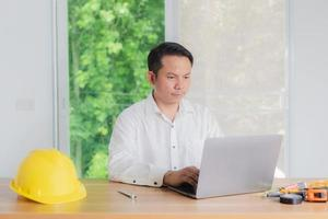 male engineer working in office photo