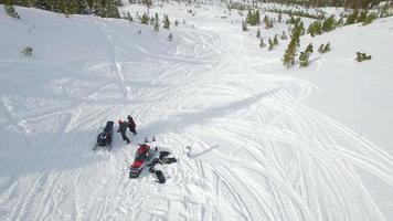 Aerial of a man snowmobiling in the mountains. video