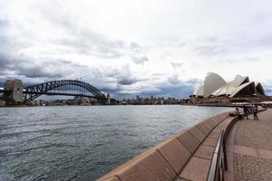 Sydney, Australia, 2021 - Tourists outside the Opera Sydney House photo