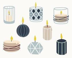 Set of burning scented candles. Hand-drawn vector illustration in doodle style. Design for holiday cards, stickers, print, Christmas,New Year