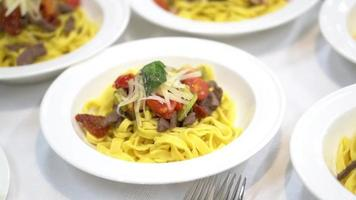 pasta in the plate. table setting in a restaurant video