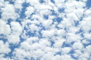 Abstract clouds sky background with illusionary sphere photo