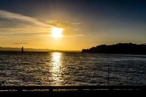 Sun Setting over Iron cove near the Birkenhead Wharf at sunset. Auckland, New Zealand photo