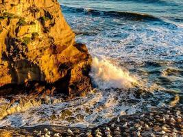 Waves crash ashore on Muriwai Beach, Auckland, New Zealand photo