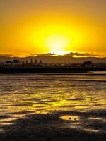 Sunset over the beach. Point Chevalier Beach, Auckland, New Zealand photo