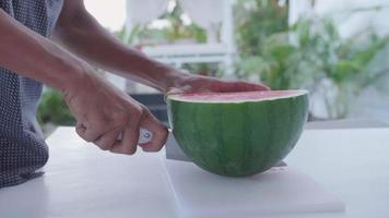 Watermelon is sliced and prepared  at a resort hotel. video