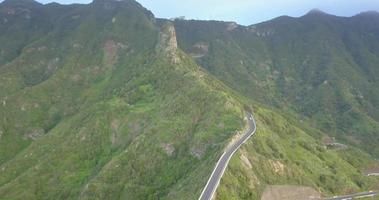 Aerial drone view of green mountains and road in Tenerife, Spain. video
