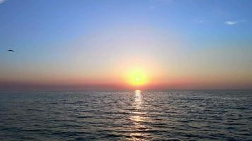 Sun and calm sea at sunrise video