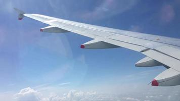 Airplane wing outside a window. video