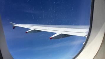 View looking outside an airplane window and wing. video