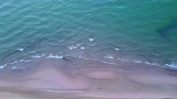 Calm Beach waves top aerial view video