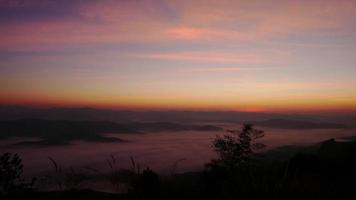 Time lapse sunrise on mountain and morning mist video