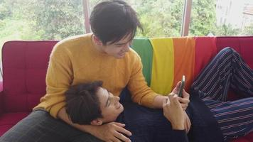 Gay couple and rainbow flag in at home with smiling faces happy Concept LGBT of homosexual love and life video