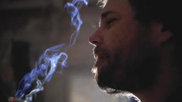 Guy with A Beard Smoking a Cigarette video