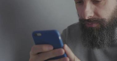 Bearded Man Watching At The Phone Screen video