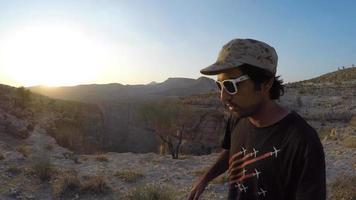 A man hikes on a mountainous trail. video