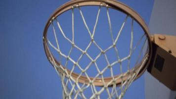 Low view of a basketball hoop looking up. video