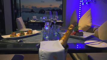 A luxury fine dining table dinner setting with champagne and meals served. video