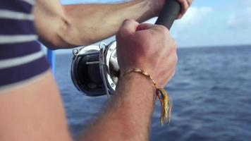A man fishing from a boat. video