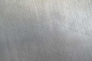 Textura de metal rayado, fondo de placa de acero cepillado foto