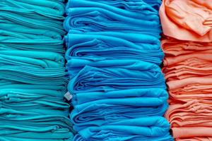 Close up of Colorful t-shirts stacked on shelves photo