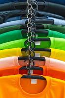 Close up of Colorful t-shirts on hangers photo