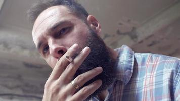 A Man Smoking a Cigarette Indoors video