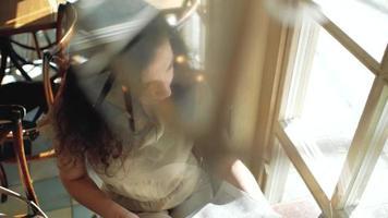 Woman Sits Near a Window video
