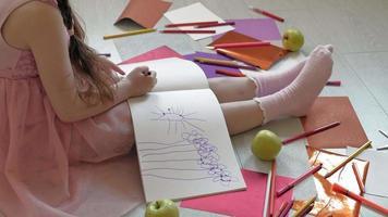 Little Girl Draws on Her Feet with Felt Pens video