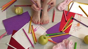 A Girl Draws on Her Feet video