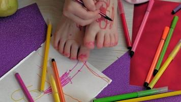 A Small Child Drawing on Feet video