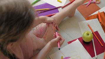 Little Girl Draws on Her Toes video