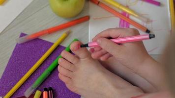 A Little Girl Draws on Her Feet with Felt Pens video