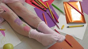 A Small Girl Drawing on Her Legs video