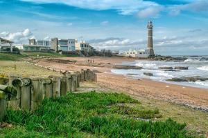 Departamento de Maldonado, Uruguay, 2021 - People on the beach near the lighthouse photo