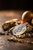 Gold bitcoin physical Bitcoin Cryptocurrency and Gold nugget grains Business concept photo